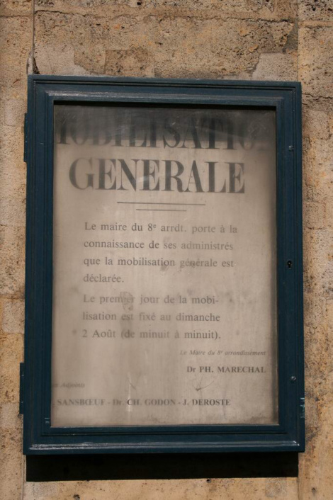 Call to Arms in rue Royale today protected in glass